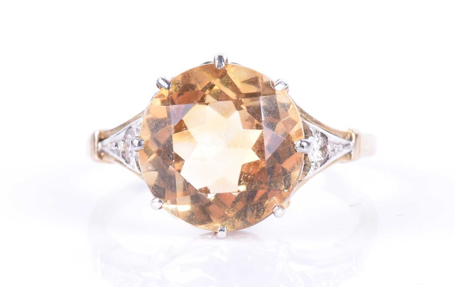 Lot 31-A yellow metal and citrine ring set with a mixed...
