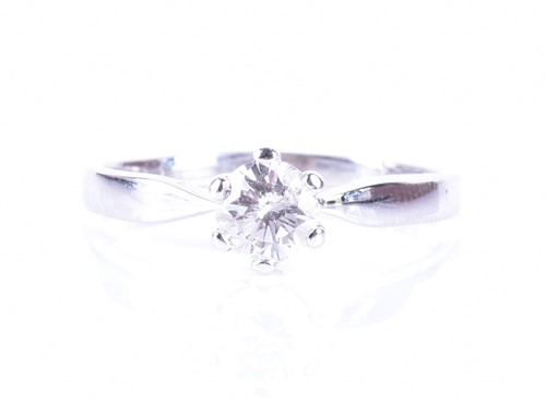 Lot 34-An 18ct white gold and solitaire diamond ring set ...