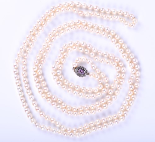 Lot 56-An opera length pearl necklace, comprised of...