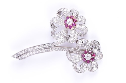 Lot 57-An impressive diamond and ruby floral brooch...