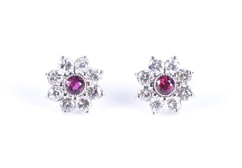 Lot 59-A pair of platinum, diamond, and ruby floral...