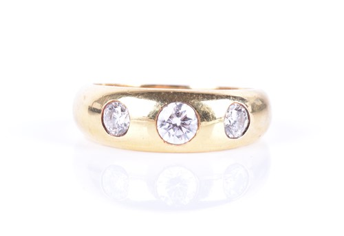 Lot 61-An 18ct yellow gold and diamond 'gypsy' ring...