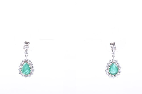 Lot 63-A pair of white gold, diamond, and emerald drop...