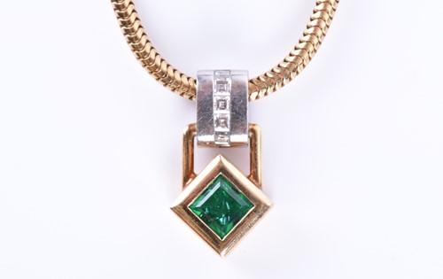 Lot 64-An 18ct yellow gold, diamond, and emerald pendant ...