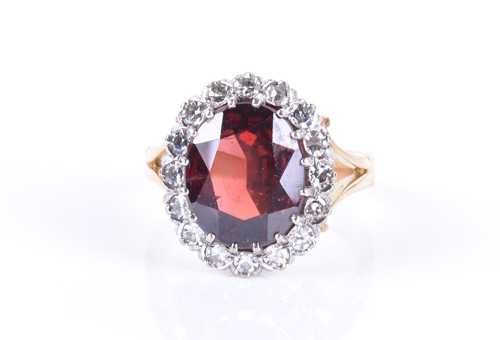 Lot 66-An 18ct yellow gold, diamond, and garnet cluster...