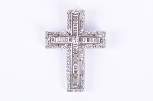 Lot 70-An 18ct white gold and diamond cross pendant set...