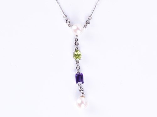 Lot 73-An 18ct white gold, diamond, pearl, amethyst, and ...