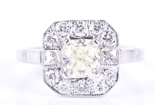 Lot 74-An 18ct white gold and diamond cluster ring...