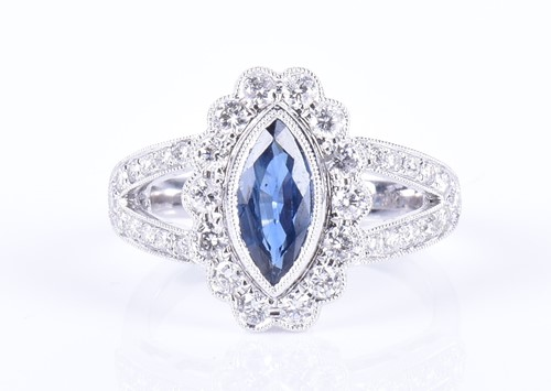 Lot 81-An 18ct white gold, diamond, and sapphire ring...