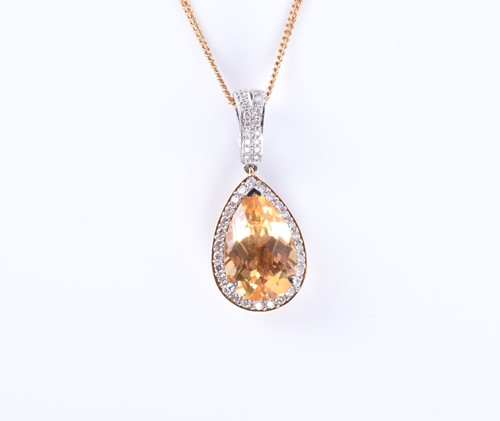 Lot 82-An 18ct gold, diamond, and citrine pendant set...