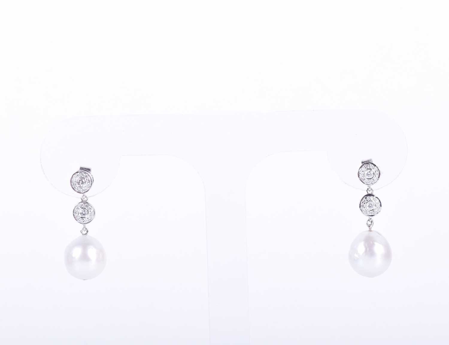 Lot 84-A pair of diamond and pearl drop earrings each...