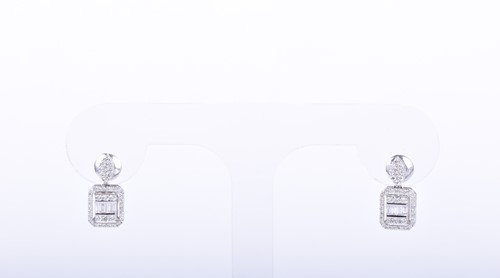 Lot 86-A pair of diamond cluster earrings the chamfered...