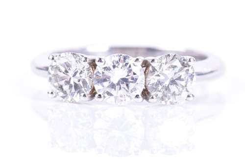Lot 111-An 18ct white gold and diamond ring set with...