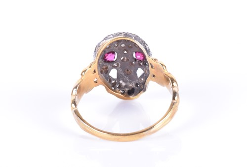 Lot 18-A yellow metal, silver, and diamond 'skull' ring...