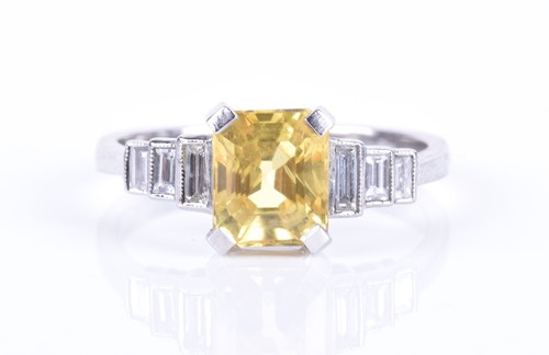 Lot 127-A diamond and yellow sapphire ring centred...