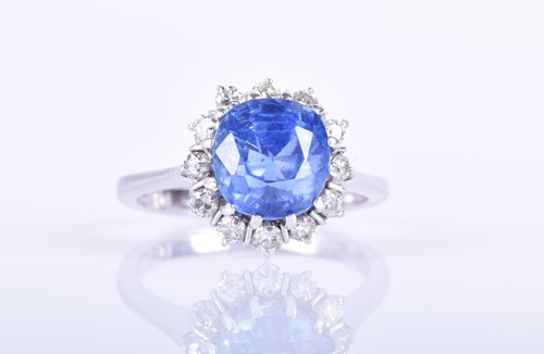 Lot 135-An 18ct white gold, diamond, and blue sapphire...