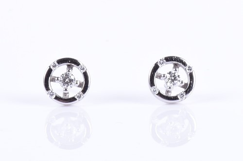 Lot 138-A pair of 18ct white gold and diamond earrings...