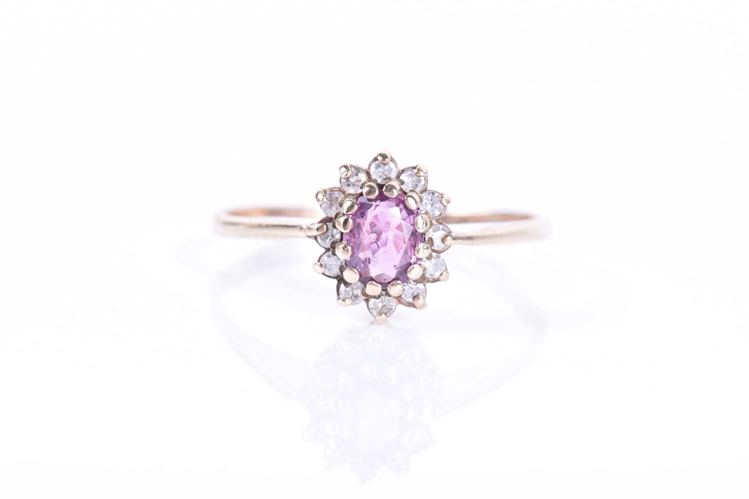 Lot 21-A 9ct yellow gold, diamond and pink sapphire...