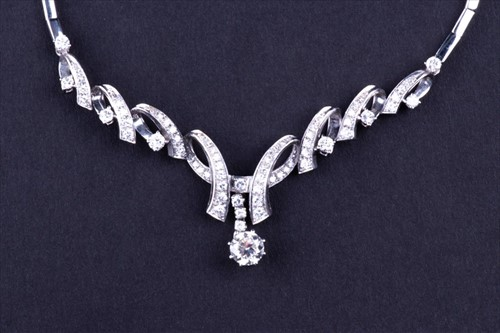 Lot 411-An 18ct white gold and diamond necklace...