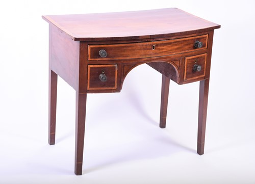 Lot 64-A Georgian mahogany bow front side table the well ...