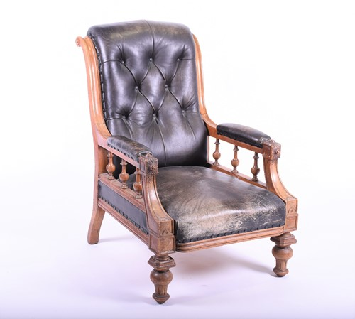 Lot 67-A Victorian oak framed armchair with scrolled...