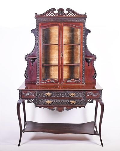 Lot 68-A late Victorian mahogany rococo revival display...