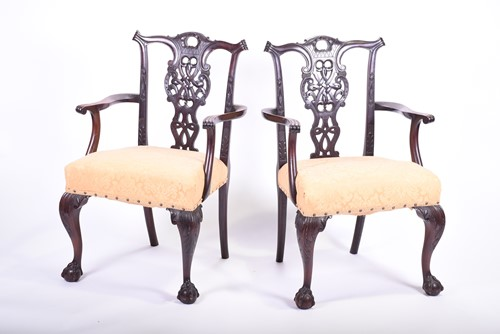 Lot 58-A pair of Georgian style mahogany elbow chairs,...