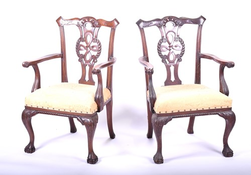 Lot 80-A pair of Georgian style mahogany elbow chairs,...