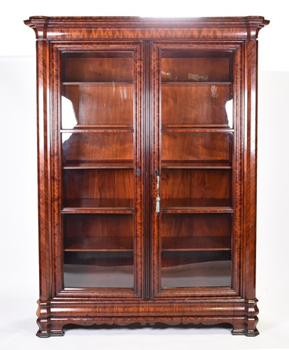 Lot 89-A large 19th century flame mahogany bookcase,...