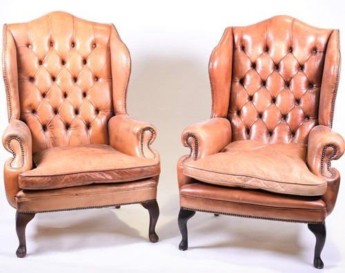 Lot 91-A pair of tan leather wingback armchairs with...