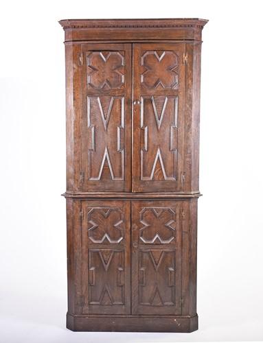 Lot 92-An early 20th century oak floor-standing corner...