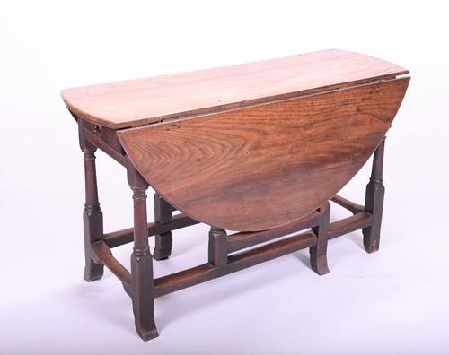 Lot 87-An 18th century oak drop flap gateleg table with...