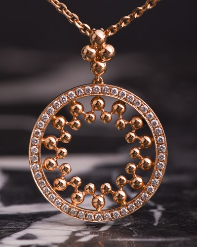 Lot 658-Boodles. An 18ct rose gold and diamond...