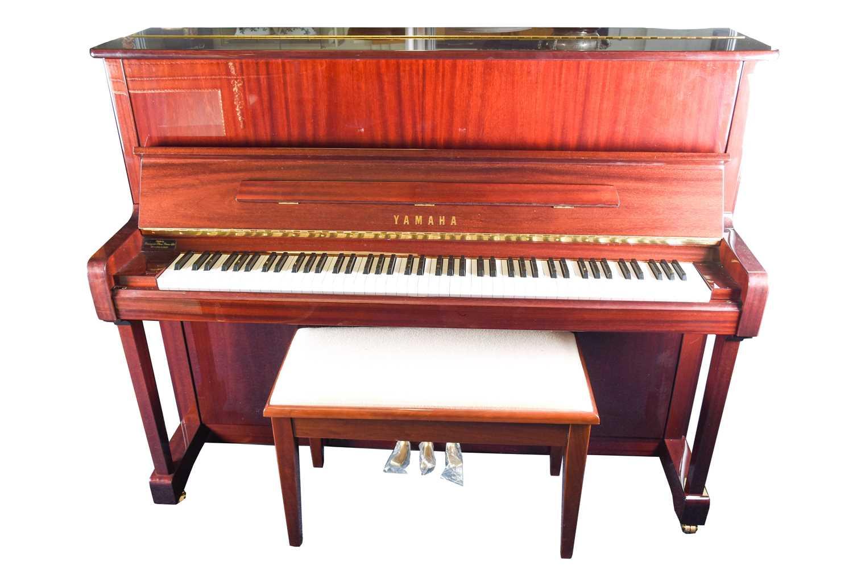 Lot 173-A Yamaha upright piano with high gloss finish,...