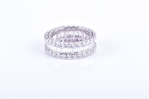 Lot 804-A fine diamond eternity ring the central row...