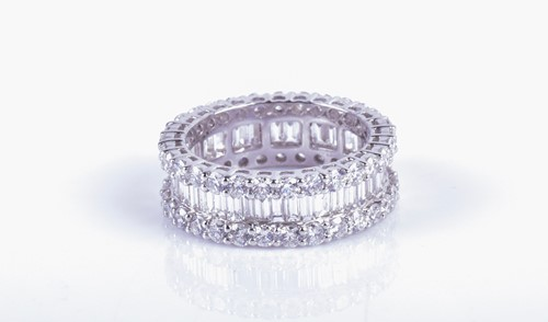 Lot 804 - A fine diamond eternity ring the central row...