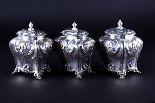 Lot 469-A set of three early George III silver tea...