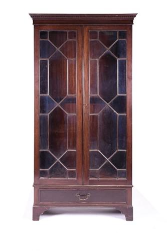Lot 83 - An early 20th century mahogany glazed bookcase,...