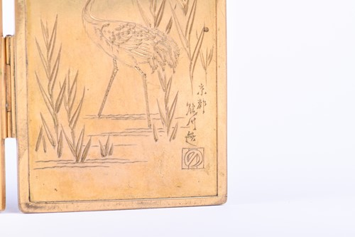 Lot 172 - A good Japanese bronze and shakudo miniature...