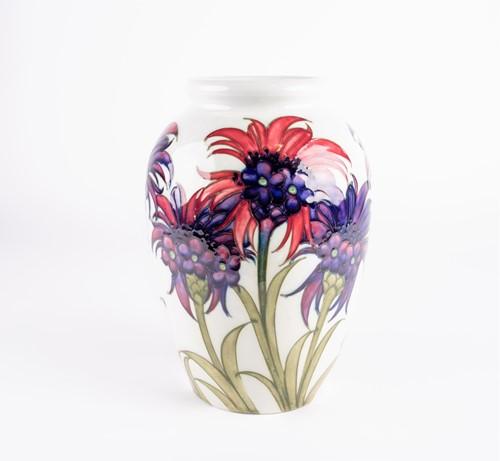 Lot 49-A William Moorcroft 'Cornflower' pattern vase,...