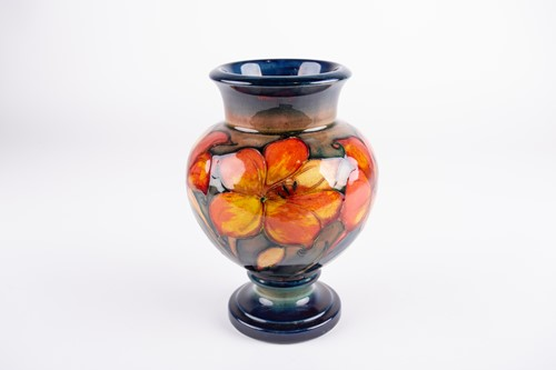 Lot 31-A William Moorcroft flambe African Lily...