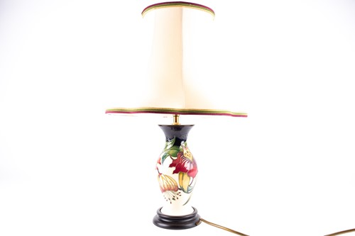 Lot 27-A Moorcroft 'Anna Lily' pattern table lamp,...