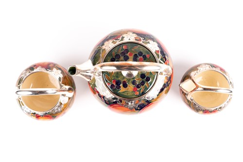 Lot 58 - A rare William Moorcroft silver overlaid...