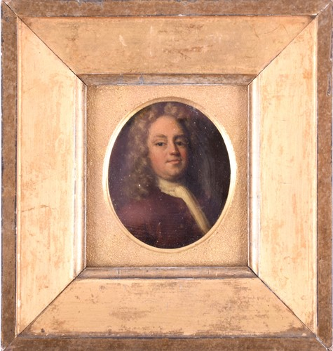 Lot 59-An 18th century oval portrait miniature of a...