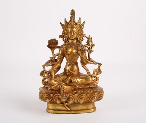 Lot 13-A Tibetan gilt bronze figure of Tara, seated...