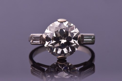 Lot 565-An impressive round brilliant-cut solitaire...