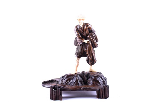 Lot 17-A Japanese carved wood and ivory figure of a...