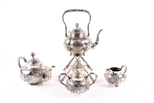 Lot 44-A Chinese four piece silver tea set by Yok...