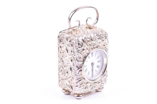 Lot 19-A Victorian miniature repousse silver cased...