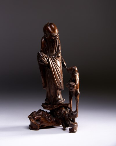 Lot 42-A Chinese carved wood figure of Shoulao and a...
